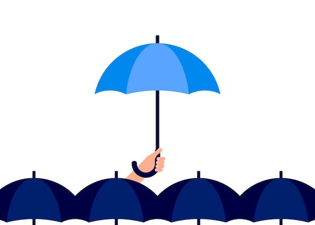 男は手に傘を持っています個人の雨傘の保護