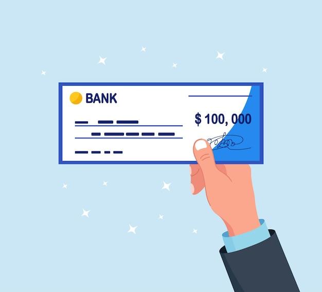 남자는 서명이 있는 은행 수표를 보유하고 있습니다. 수표 책을 손에 들고 사업가입니다. 지불 및 재무 운영