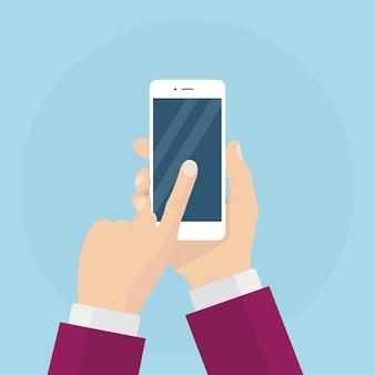 Мужчина держит смартфон. белый мобильный телефон в руках