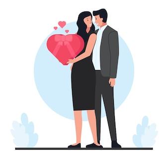 남자는 발렌타인 데이에 선물을 안고있는 여자를 안아줍니다.
