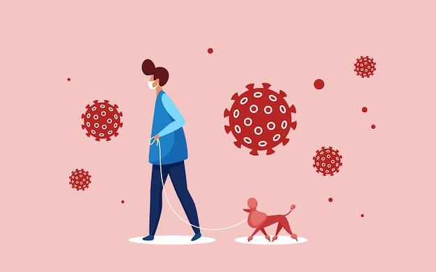 ペットの犬と一緒に歩く医療呼吸マスクの男