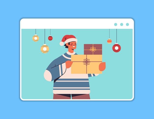 楽しい新年とメリークリスマスの休日のお祝いのコンセプトウェブブラウザウィンドウの水平方向の肖像画のベクトル図を楽しんでいるギフトボックスを保持しているサンタ帽子の男