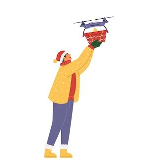 무인 항공기 평면 벡터 일러스트 레이 션에서 크리스마스 선물을 받는 산타의 모자에 남자. 화이트에 격리.
