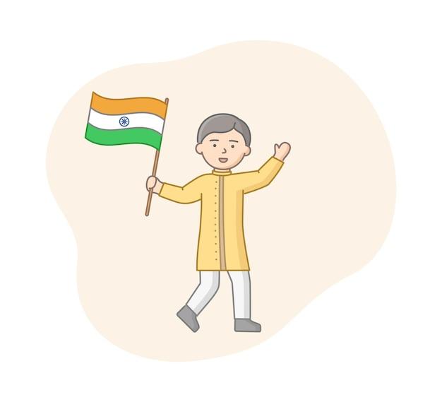 Человек в традиционной одежде держит индийский флаг. мужской персонаж в желтом костюме машет рукой и улыбается. вектор минималистского искусства с контуром. линейная иллюстрация концепции национальности.