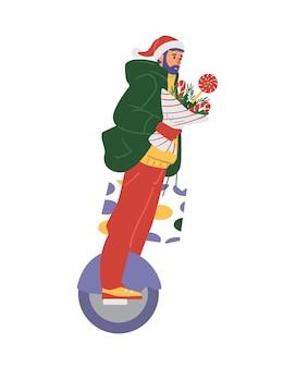 겨울 옷을 입은 남자와 선물과 겨울 꽃다발을 들고 모노 휠을 타고 산타 모자