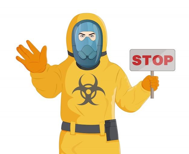 黄色の防護服と一時停止の標識で立っている防毒マスクの男