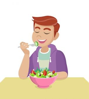 男はサラダを食べています。