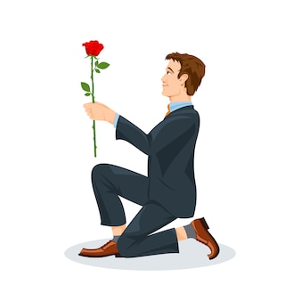 Man is kneeling with a flower.
