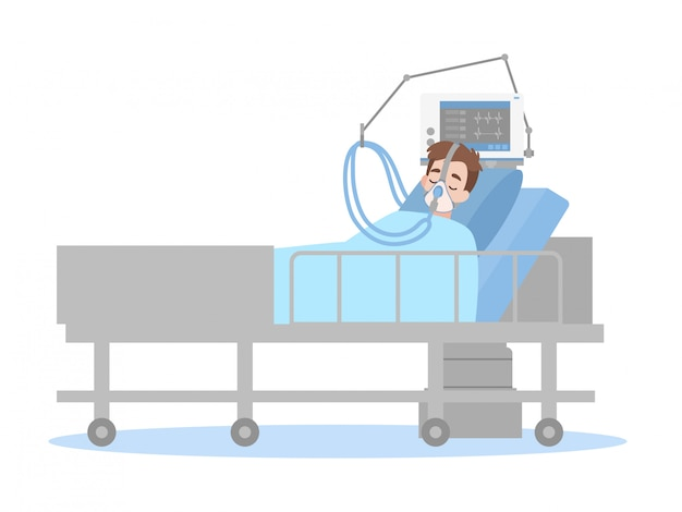 A man is lying on a bed in a hospital room