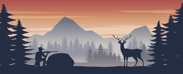 Человек стреляет в оленей в дикой природе