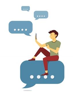 男は、バブルアイコンのチャットと携帯電話でのチャットに座っています。