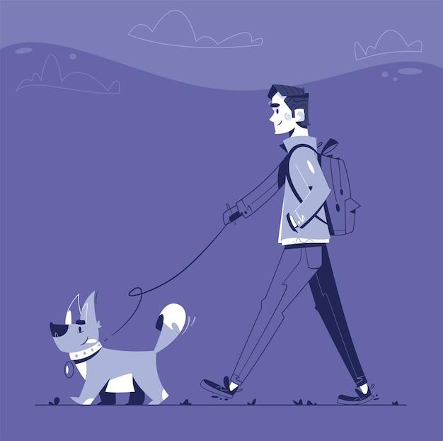 남자는 밤에 강아지와 함께 걷고있다. 행복한 개 워커. 재미있는 강아지