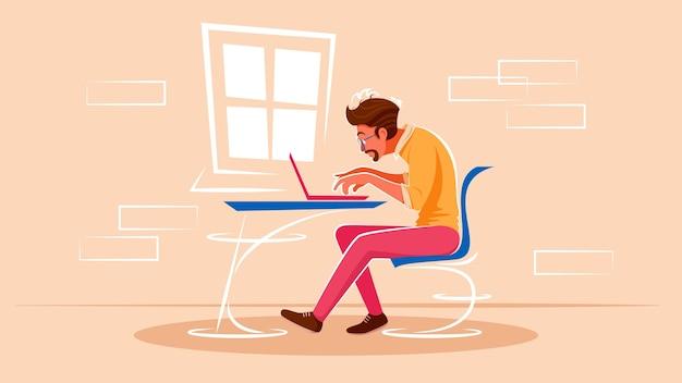 남자는 창가에 앉아 노트북에서 일하고있다.