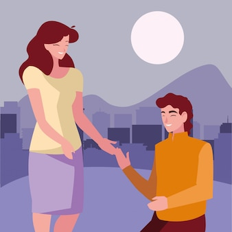 Man kneeling with woman holding hand