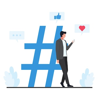 Man leaned against the large hash tag symbol holding the phone.