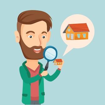 家のベクトル図を探している男性。