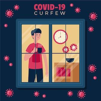 코로나 바이러스 통금 시간 동안 창 밖을 보는 남자