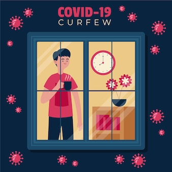 Man looking outside the window during coronavirus curfew