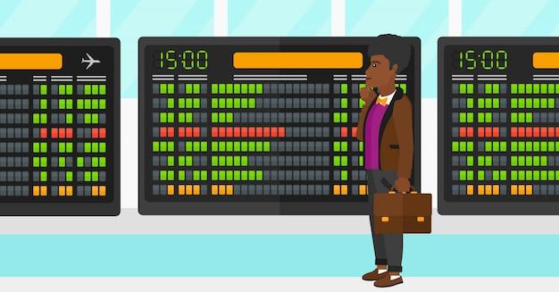 Man looking at schedule board