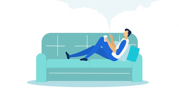 Man lying on sofa holding cup and smoking flat.