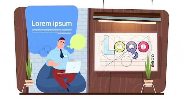 Man office worker or designer using laptop computer work in modern creative space