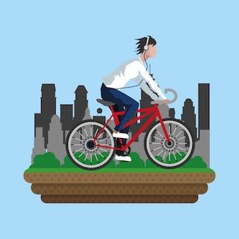 Man on bike with city