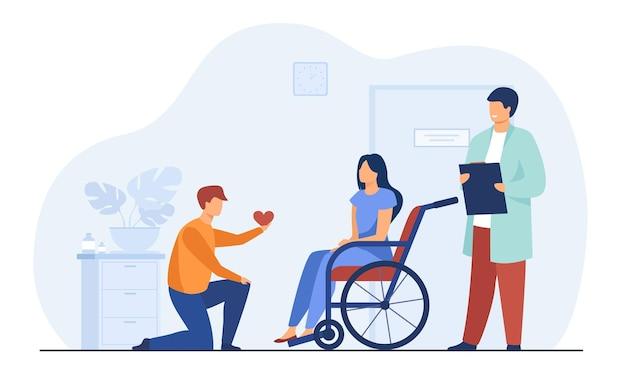 Мужчина на коленях дает сердце женщине в инвалидной коляске