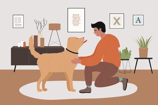 居心地の良い家のリビングルームのインテリア幸せな友情で犬の友人と遊ぶ男のペットの所有者