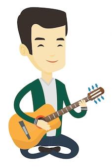 Человек играет на акустической гитаре.