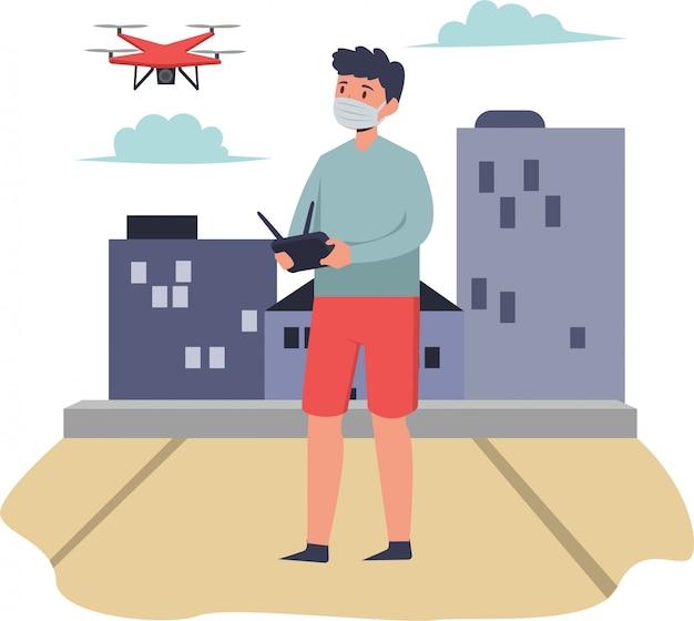 Человек играет дрон снаружи при использовании медицинской маски