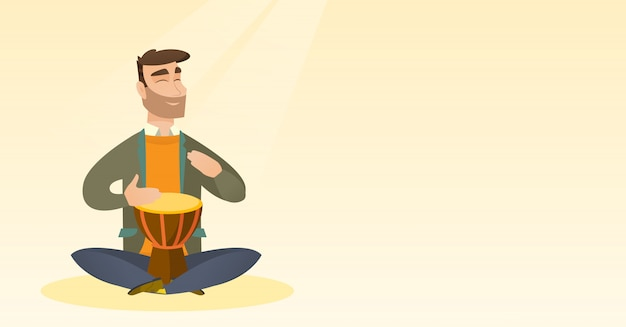 Man playing the ethnic drum