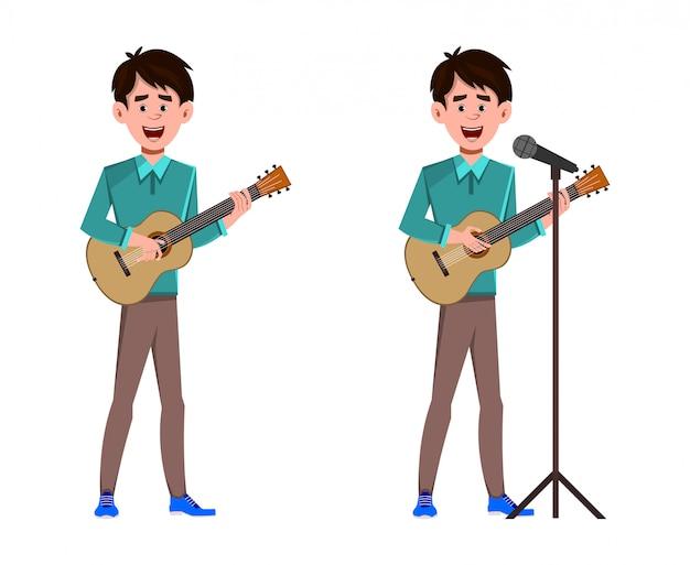 男はギターを弾いて、曲に署名