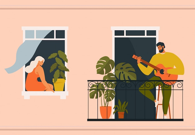 Man playing guitar on balcony and woman listening from her window