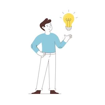 남자는 흰색 배경에 고립 된 전구를 가리 킵니다. 새로운 창의적 또는 혁신 아이디어