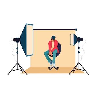 写真スタジオでポーズをとる男、フラットなデザインイラスト