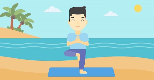 Man practicing yoga tree pose on the beach.