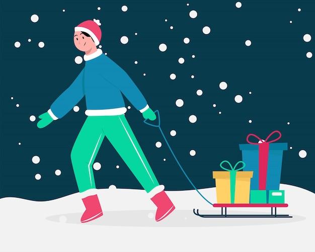 Человек тянуть поезд снег с рождественскими подарками