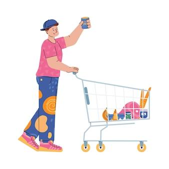 Мужчина толкает тележку для покупок и берет товары с продуктовой полки