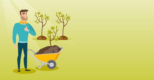 Man pushing wheelbarrow with plant.