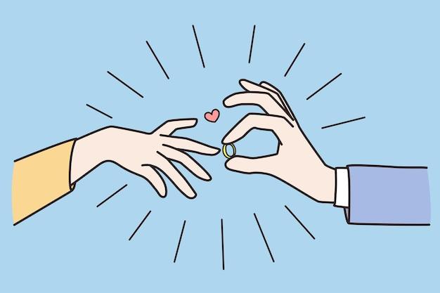 남자 여자 손가락에 반지를 넣어