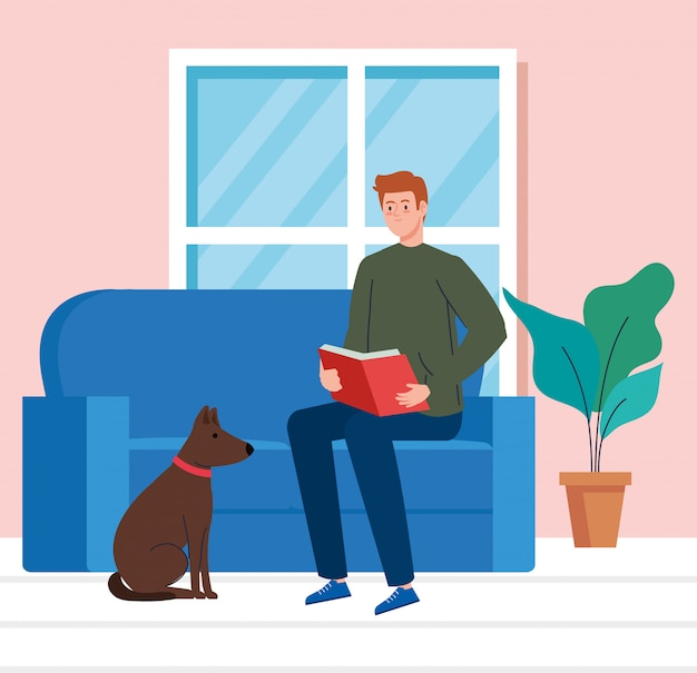 Man reading book in the house, sitting in couch with dog mascot