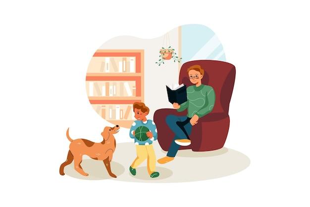 Человек читает книгу, пока его ребенок играет с собакой