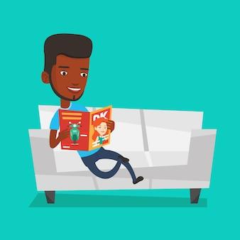 Человек читает журнал на диване