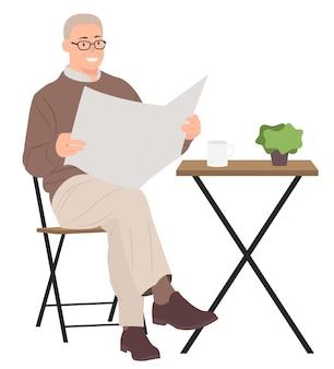 커피 테이블에 앉아 신문을 읽는 남자