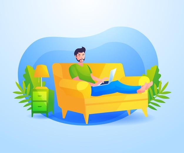 男はソファに座ってラップトップで作業してリラックス