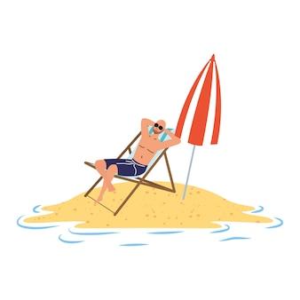 椅子と傘に座っているビーチでリラックスした男