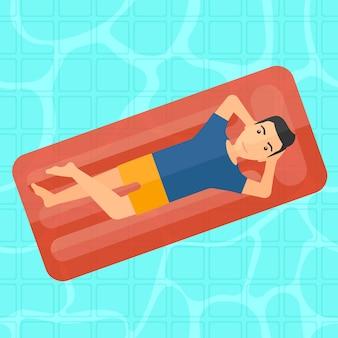 Man relaxing in swimming pool.