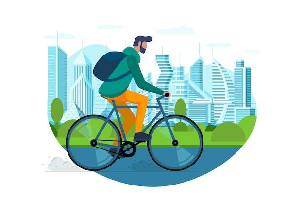 男は都市公共公園で自転車に乗る都市屋外環境にやさしい輸送コンセプト若者