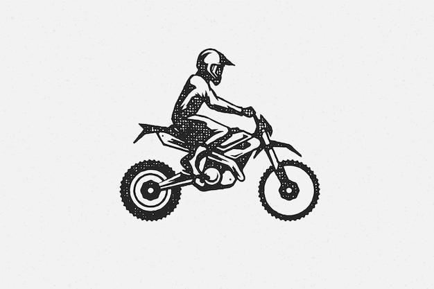 モトクロスバイクシルエット手描きインクスタンプの男のライダー