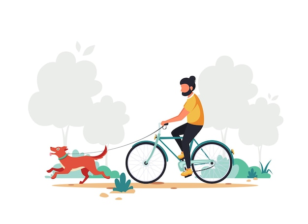 Man riding bike with dog in the park.